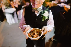Boy showing pasta bowl from Billotti's Catering pasta bar